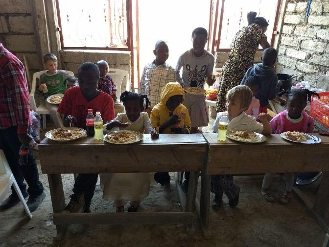 Children eat lunch after children's Bible hour at church.